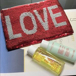 Clarins sequin makeup bag, 50ml lotion & cleanser